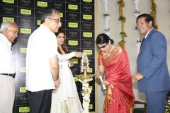 Ms.Pushpa Shetty,Director Nitesh Land Ltd, lighting the traditional lamp on the occasion of the NITESH LOGOS's ground breaking ceremony