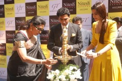 Mr. Nitesh Shetty, Founder & Chairman, Nitesh Land Limited and Ms. Sonam Kapoor, Bollywood Actress and Style Icon, lighting the traditional lamp at the Ground Breaking Ceremony of Nitesh Mall the Futuristic Shopping Mall and Entertainment destination at Indiranagar, with Mr. George Thangaiah, the partner.