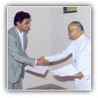 Your Grace The Most Rev. Bernard Moras, Archbishop of Bangalore with Mr. Nitesh Shetty at the signing of the 5-Star Hotel Deal for the Residency Road Project.