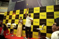 Virat-Kohli-India-Cricket-Captain-with-Mandira-Bedi-celebrity-and-host-interacting-with