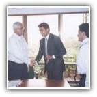 L to R: Mr. Anand Nayak, Executive Vice President Corporate Human Resources - ITC Limited and Mr. Nitesh Shetty, Founder & Chairman- Nitesh Land after signing of the contract. Also seen in the picture (left) is Mr. Rajendra Mishra, Assistant Solicitor - ITC Limited and (right) Mr. L.S. Vaidyanathan, Director Operations - Nitesh Land.